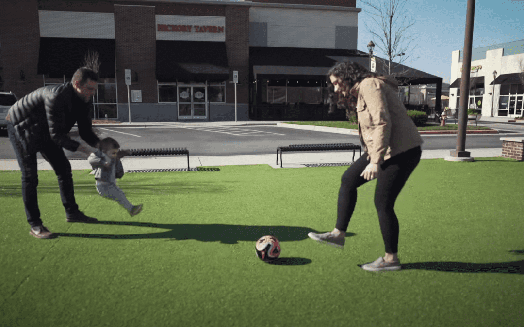 Omegas Sports neighborhip series video with Megan, Harrison and Dean playing soccer in the courtyard